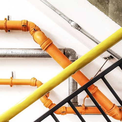 Colourful pipes Orange Color Orange Yellow Angles And Lines Angles Diagonals Close-up Pipe - Tube Pipeline Valve Pipe Water Pipe Smoke Stack
