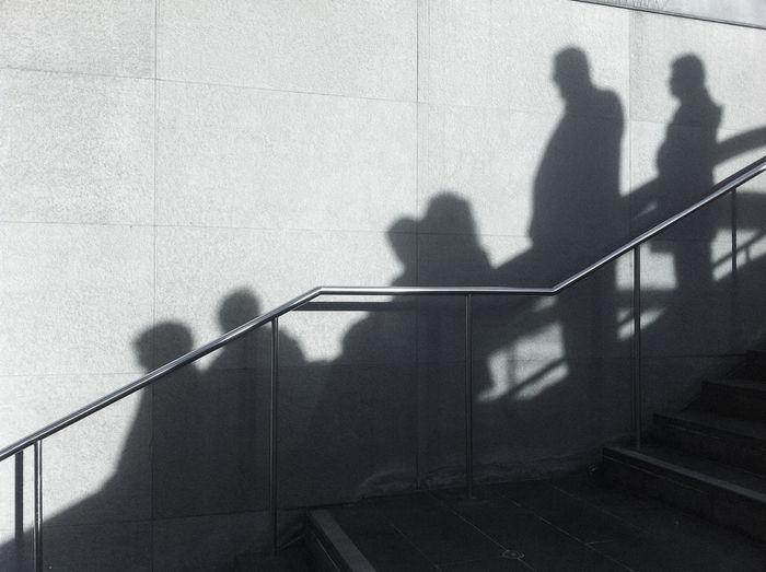 Potsdamer Platz: Shadows of people on escalator Afternoon Berlin Potsdamer Platz Escalator Indoors  Pattern People Railing Shadows Sun Tiles Wall