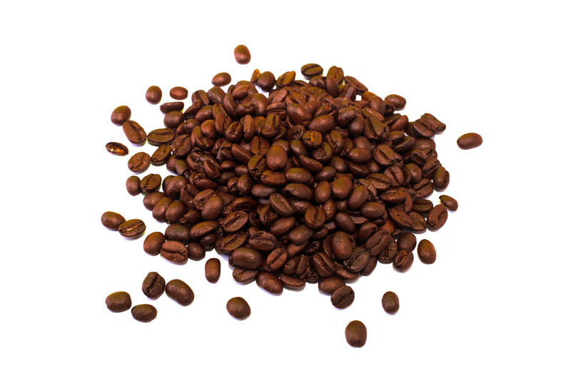 Directly above shot of coffee beans against white background