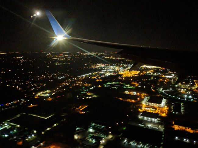 City lights outside of a plane Flight Blurred Background Backgrounds Day Beauty In Nature Summer Light Night Building Exterior City Astronomy City Illuminated Light Beam Astrology Sign Airplane Star - Space Galaxy Sky Building Exterior Residential District Cityscape Tall - High Settlement Historic Space Exploration Constellation HUAWEI Photo Award: After Dark
