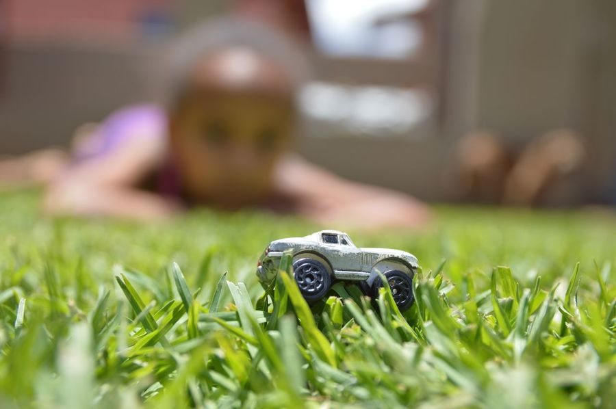 Grass Close-up Outdoors Day Nature Four Wheels Hobby Playing With Kids Fun Time Miniature Car Child Blurred Background