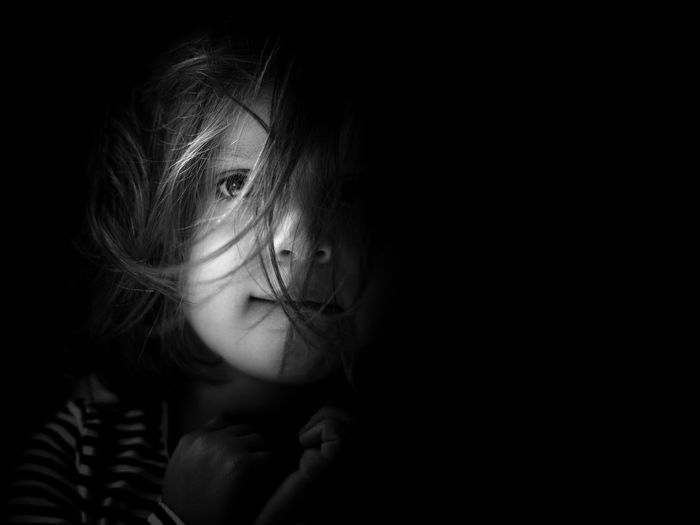 Hidden Portraiture Kids Of EyeEm Children Hair Kids Kids Being Kids Portraits Black Black Background Child Childhood Children Only Children Photography Copy Space Cute Dark Eye Front View Girl Girls Headshot Hidden Human Face Kid Looking At Camera Portrait Portrait Photography EyeEmNewHere The Portraitist - 2018 EyeEm Awards