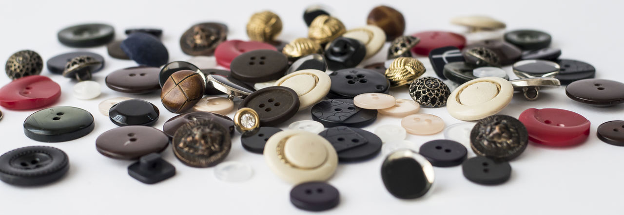 High angle view of various buttons on table