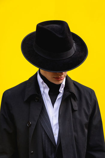 London Fashion Week Mens 2019 Redefining Menswear Clothing Hat Suit One Person Front View Yellow Formalwear Well-dressed Indoors  Studio Shot Real People Portrait Waist Up Men Black Color Standing Fashion Obscured Face Menswear Mensfashion Street Style London Fashion Fashion Photography