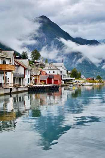Beautiful Nature EyeEmNewHere Norway Scenic Architecture Beauty In Nature Building Building Exterior Built Structure Cloud - Sky Day Fjord House Mountain Nature No People Outdoors Reflection Scenics - Nature Sky Village Water Waterfront