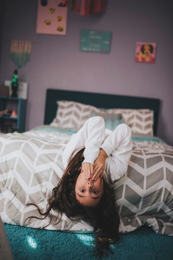 Girl laying in her room. Asian  One Person Child Indoors  Childhood Domestic Room Lying Down Offspring Bed Lifestyles Bedroom Home Interior Females Hair Furniture Relaxation Innocence Portrait Girls Women Hairstyle