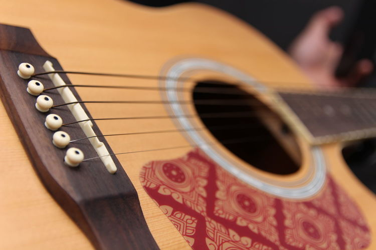 Arts Culture And Entertainment Music Musical Instrument String Instrument Musical Equipment String Close-up Guitar Musical Instrument String Indoors  Selective Focus Wood - Material Brown Studio Shot Focus On Foreground No People Acoustic Guitar Wind Instrument Performance Still Life Rock Music