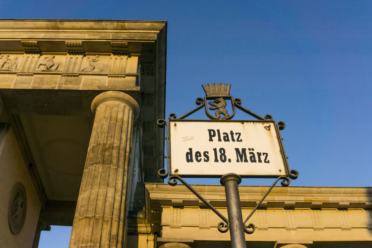 Platz des 18. März sign at Brandenburg Gate 'Platz Des 18.März' Berlin Brandenburg Gate Germany 🇩🇪 Deutschland Horizontal Sign Architecture Blue Clear Sky Color Image Communication Day Low Angle View No People Outdoors Sky Text