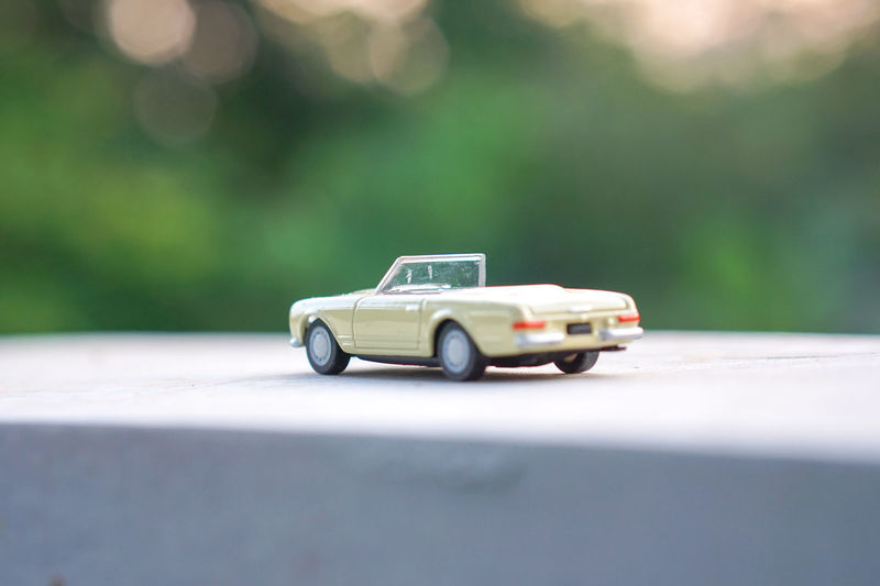 Close-up of toy car on table outdoors