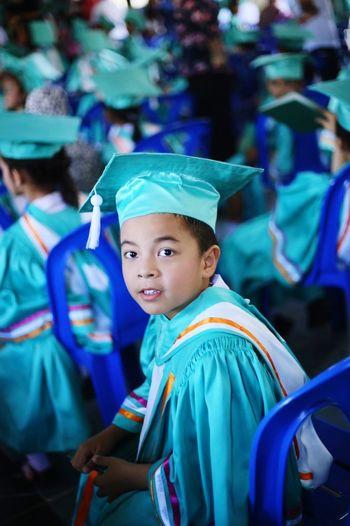 Portrait Of Boy Wearing Graduation Gown