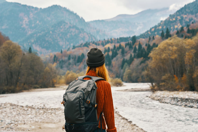 Rear view of woman looking at mountains