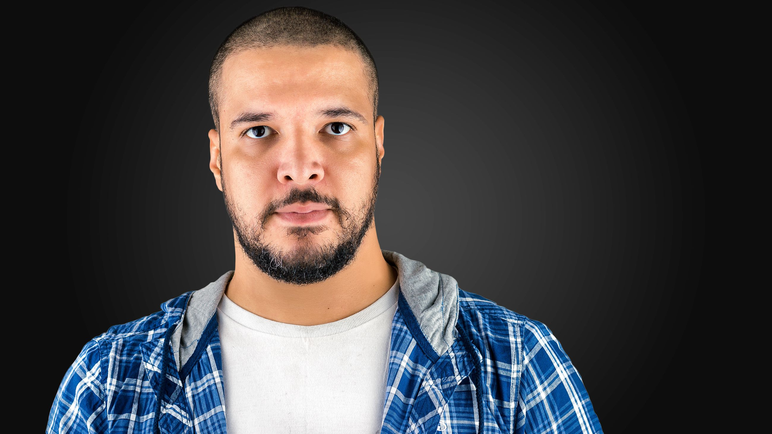 portrait, looking at camera, person, young adult, headshot, front view, lifestyles, black background, studio shot, young men, indoors, leisure activity, mid adult, casual clothing, mid adult men, close-up, head and shoulders, human face