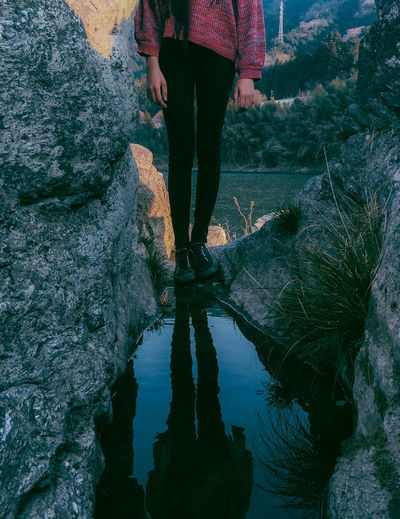 // paused // Beauty In Nature Blue Day Girl Human Leg Lake Lifestyles Live For The Story Low Section Mirror Nature One Person Outdoors Real People Reflection Reflection_collection Reflections Rock - Object Shootermag Shootermagazine Standing The Great Outdoors - 2017 EyeEm Awards Walking Water Women Out Of The Box