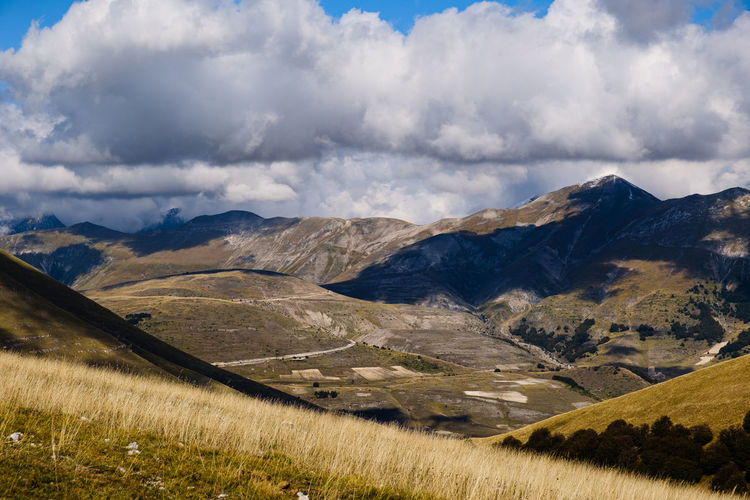 Scenic view of mountains against sky in castelluccio , umbria italy