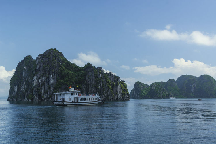 Vietnam Halong Bay Beauty In Nature Cloud - Sky Day Mode Of Transport Mountain Nature Nautical Vessel No People Outdoors Sailing Scenics Sky Tranquility Transportation Tree Water Waterfront