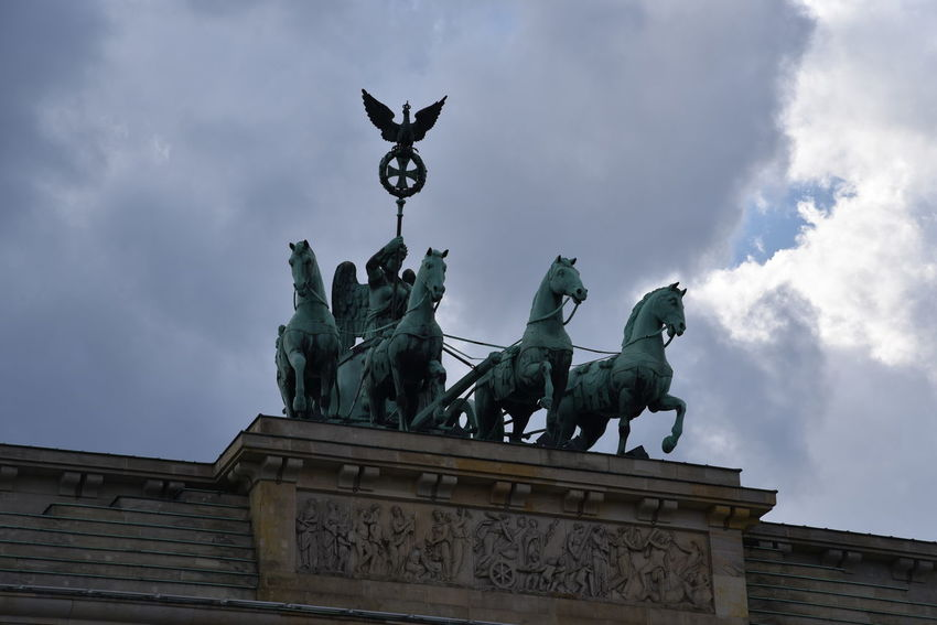 Berlin-Mitte Brandenburg Gate Quadriga Architecture Art And Craft Berlin-Mitte Brandenburger Tor Building Exterior Built Structure Cloud - Sky Day Human Representation Low Angle View No People Outdoors Sculpture Sky Statue Travel Destinations