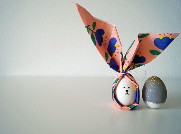 Close-up of easter eggs against wall