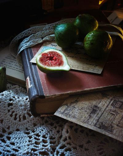 High angle view of figs on book at home