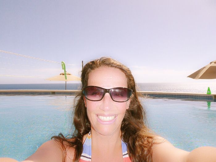 Getty Premium Collection EyeEm Selects Sea Water Beach Vacations Summer Sunglasses Outdoors One Person Smiling Headshot Nature Portrait Day Looking At Camera Happiness Young Adult Beauty In Nature Clear Sky Premium Collection Young Women Selected For Premium Close-up Cabo San Lucas Cabo