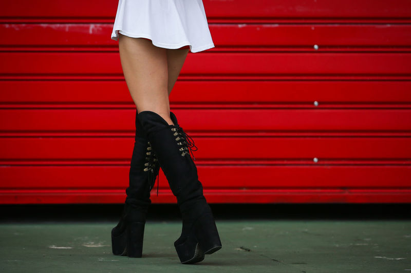 APRIL 10, 2015 A woman with long legs WALK IN THE PITS OF RACING CIRCUIT IN CORDOBA ARGENTIA Beauty Boots Contrast Fashion Legs Lifestyles Walk Woman