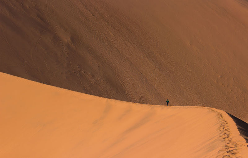 Desert Isolated Lines Namibia Orange Perspective Perspectives Perspectives on Nature Arid Climate Climate Clouds Contrast Dune Extreme Terrain Lines And Shapes Nature One Person Orange Color Outdoors Sand Sand Dune Scenics - Nature