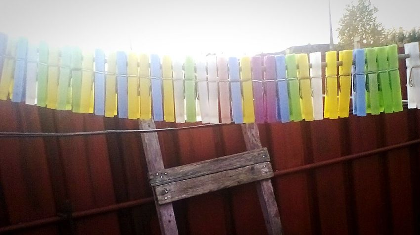 Multi Colored No People Day Picket Fence Outdoors Close-up Showcase: 2016 Showcase: November Clothespins @ionitastela Clothespin Ionitastela @engelberta Edited By @wolfzuachis @wolfzuachis Family Engelberta Beautifully Organized Cable Wire Adapted To The City EyeEm Diversity BYOPaper! Be. Ready.