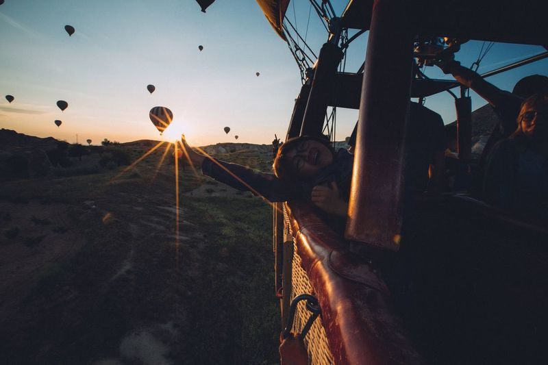 Real happiness Real People Transportation Mode Of Transport Men One Person Sky Adventure Leisure Activity Lifestyles Landscape Fun Outdoors Land Vehicle Sunset Nature Hot Air Balloon Day One Man Only People EyeEmNewHere EyeEm Best Shots Nature City Young Adult Flying
