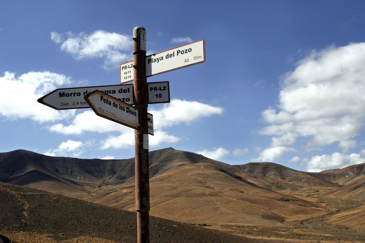 View of road sign against sky