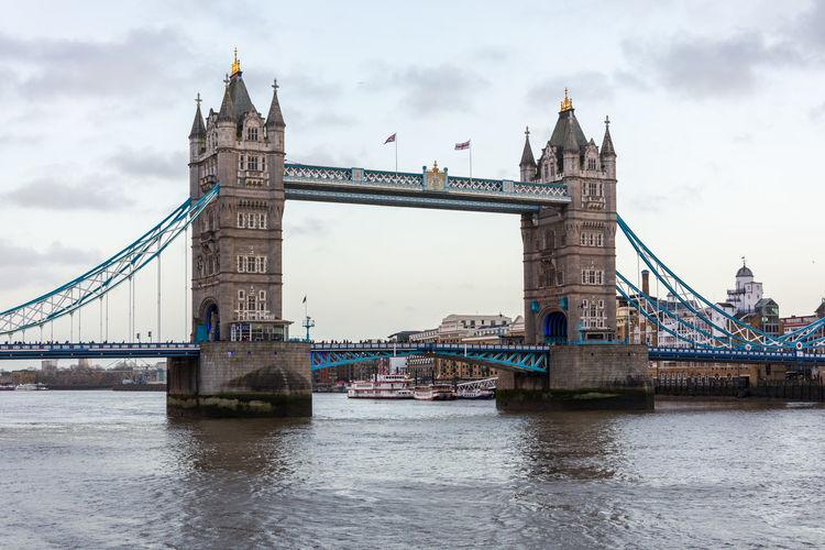 Tower bridge over thames river against sky