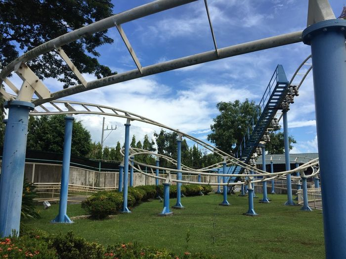 Metal structure in park against sky