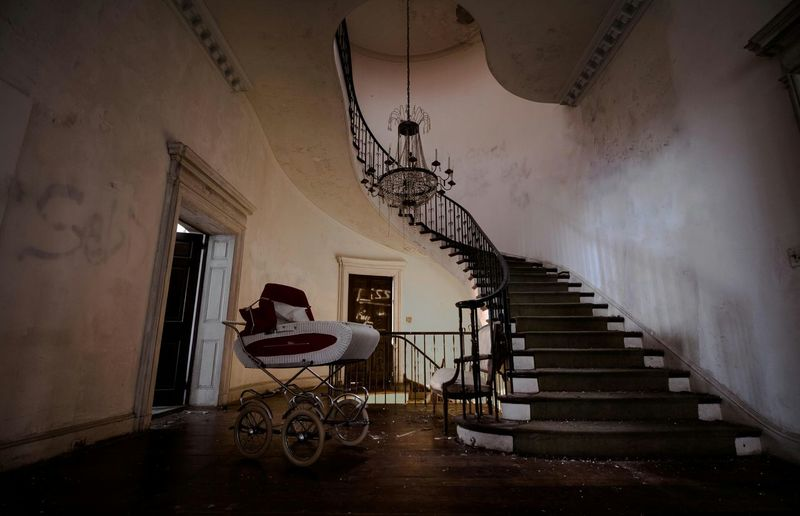 Baby Carriage By Stairway In Old House