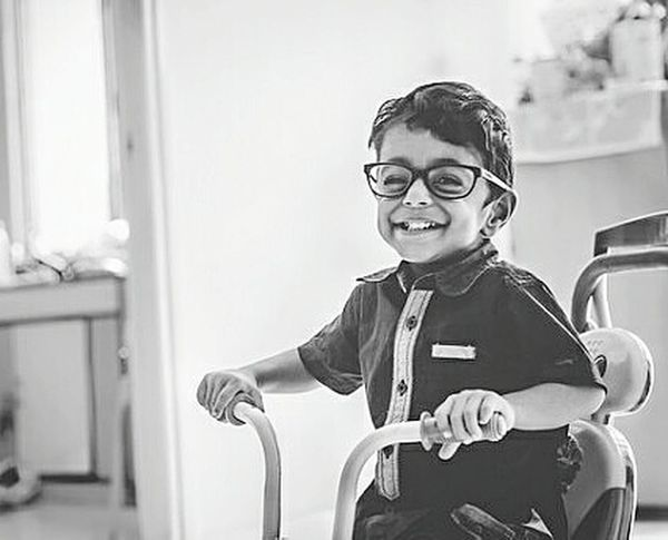My naughty baby wearing my spectacles and cycling around the home. Lifestyles Indoors  Portrait Looking At Camera Casual Clothing Childhood Innocence Person Front View Leisure Activity Focus On Foreground Babyboy Baby Love  Babyphotography Babyportraits Blackandwhite Naughtyboy First Eyeem Photo