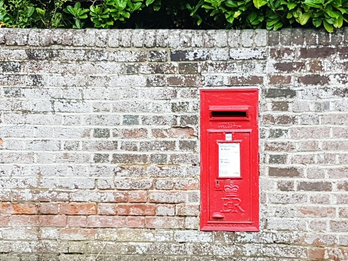 Red Outdoors Day No People Communication Brick Wall Red Post Box