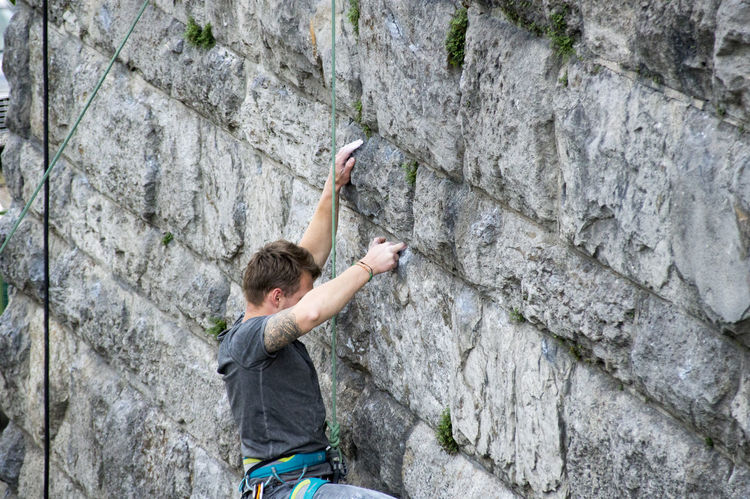 Adult Adults Only Adventure Arms Raised Cliff Climbing Climbing Rope Danger Determination Extreme Sports Human Arm Human Body Part Limb One Man Only One Person Only Men People RISK Rock - Object Rock Climbing Rock Face Rope Skill  Sport Strength
