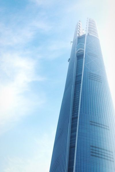 Majestic Architecture Low Angle View Built Structure Building Exterior City Skyscraper Sky Modern Tower No People Outdoors Office Block High Skyline Seoul Korea Lotteworld Tower Glass - Material My Year My View Office Building Exterior Vertical Pattern Blue Sky Blue Office Building