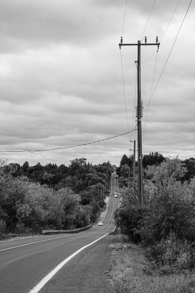 stranded at the roadside Telephone Line Technology Electricity Pylon Electricity  Road Cable Fuel And Power Generation Rural Scene Power Supply Power Line  Telephone Pole Country Road Double Yellow Line Countryside vanishing point Dramatic Sky Overcast
