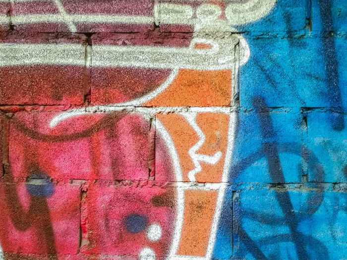Abandoned Architecture Backgrounds Block Brick Wall Built Structure Cement Wall Close-up Colorful Contemporary Day Design Exterior Graffiti Wall Home Idea Multi Colored No People Outdoors Pattern Red Spray Paint Style Surface Teenager