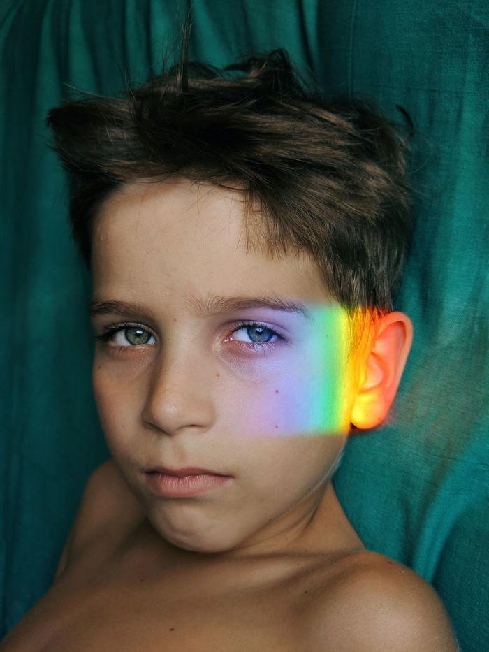 Prims light falling on face of shirtless boy
