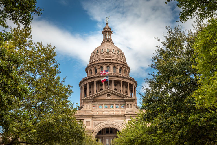 Texas Capitol Austin State Building Capital Sky Day Downtown Dome Government Travel Blue Architecture City USA Landmark Monument Congress Old Historic Flag Federal Tourism Stone Cloud Statue America Law Politics United Legislature  TX Political Symbol Spring Space Green Building Exterior Built Structure Travel Destinations Outdoors No People