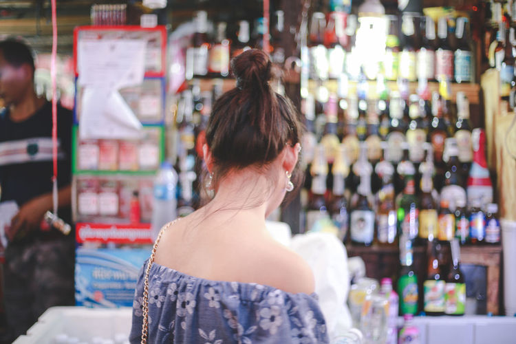 Because if she's happy I am happy too. Rear View Choice One Person Adult Store Bottle Waist Up Retail  Shopping Variation Shelf Customer  Women Standing Hairstyle Container Business Consumerism