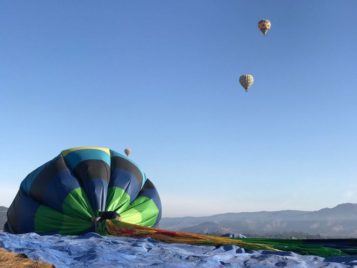 Hot air balloons against clear blue sky