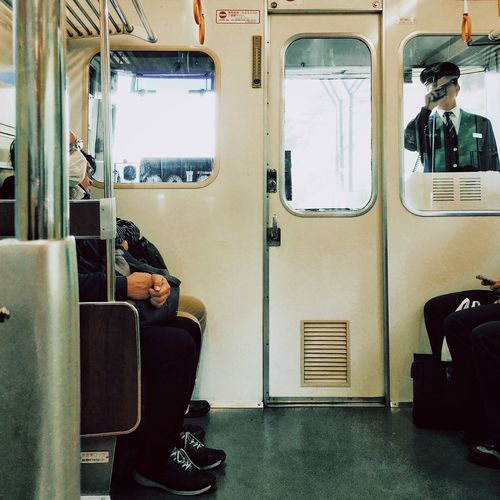 View Of People Traveling In Train