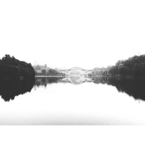Running in the park. Bridge Lake Blackandwhite