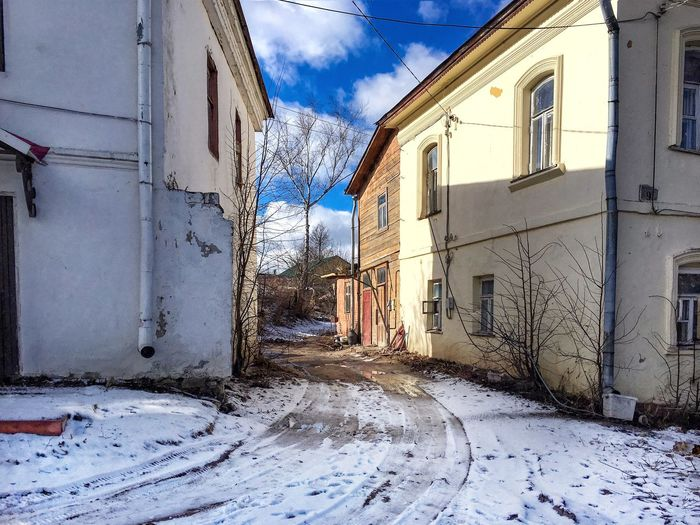 Russian town street Building Exterior Architecture Built Structure Snow Winter Sky House Cold Temperature Weather Outdoors Residential Structure No People Residential Building Day Bare Tree Nature Street Russian Town Old Buildings Spring Street March Weather Classic Street Spring View The Secret Spaces