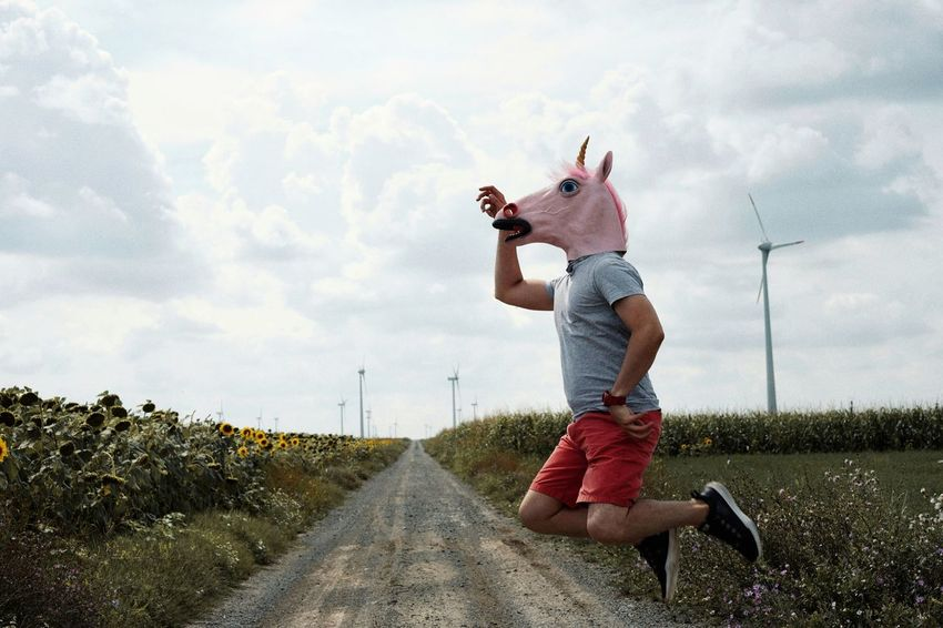 Jump Jumping Unicorn Unicorn Head Wind Turbine Wind Power Windmill Mask Mask - Disguise Disguise One Man Only Men People One Person Rural Scene Standing Sky Cloud - Sky Casual Clothing Farmland Agricultural Field Field The Still Life Photographer - 2018 EyeEm Awards The Traveler - 2018 EyeEm Awards The Portraitist - 2018 EyeEm Awards The Great Outdoors - 2018 EyeEm Awards The Creative - 2018 EyeEm Awards Summer Sports Be Brave