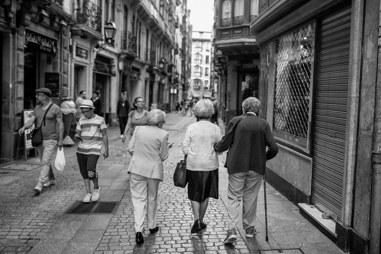 architecture, building exterior, walking, group of people, city