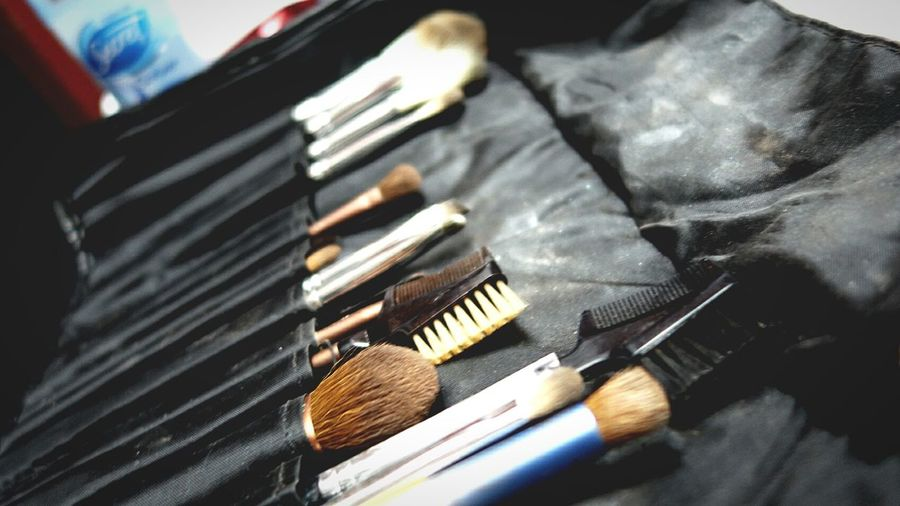 Close-Up Of Make-Up Brushes In Bag