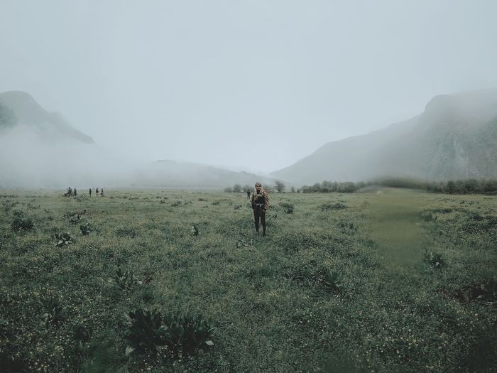 There you are Land Beauty In Nature Mountain Real People Landscape Nature Sky Fog Day Environment Plant Non-urban Scene Tranquil Scene Field Tranquility Outdoors Green Color People Scenics - Nature