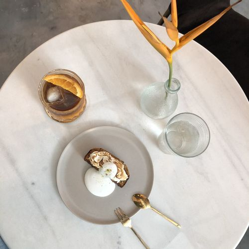 High angle view of wine in glass on table