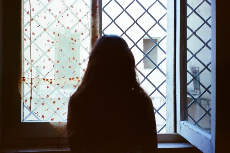 Shadows & Lights Analogue Photography 35mm Film 35mm Film Window One Person Real People Indoors  Women Lifestyles Home Interior Standing Adult Rear View Pattern Silhouette Looking Looking Through Window Contemplation